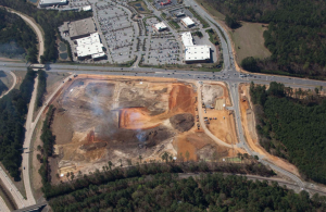 An aerial photo  shows the land directly  across from White Oak  Crossing having been  cleared for development.  Cabela's is expected to  start construction on the  land in June.